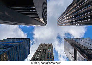 Looking up at a few impressive skyscrapers in Chicago