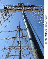 Looking up at a sailing ship