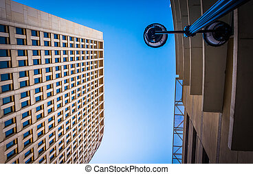 Looking up at a streetlamp and the Brandywine Building in ...