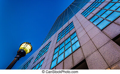 Looking up at a streetlight and the PNC Bank Center building...