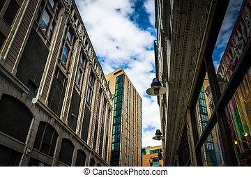 Looking up at buildings along a narrow street in Boston, Massachusetts.