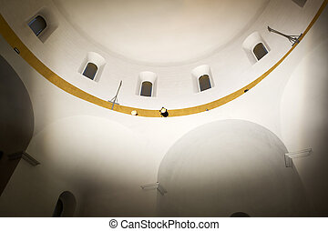Looking up at church ceiling.