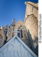 Looking up at church with cross