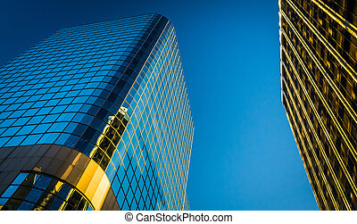 Looking up at modern buildings in downtown Wilmington, ...