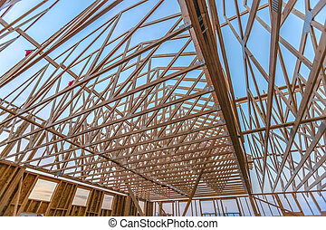 Looking up at new wood beams of building