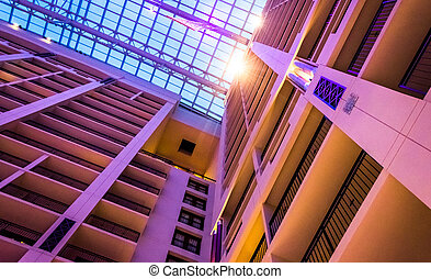 Looking up at the ceiling and many stories of the Gaylord National Resort, in National Harbor, Maryland.