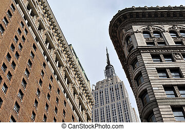 Looking up at the Empire State Building from the street.