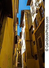 Looking up in Narrow Street, Florence Italy.