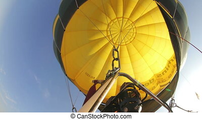 looking up into a hot air balloon during a ride