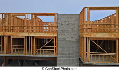 Looking up at new construction beams under industry residential building