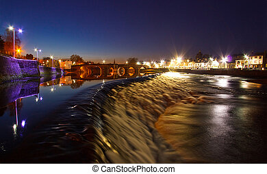 Looking upstream over the Caul towards the Devorgilla Bridge on the River Nith in Dumfries at Night