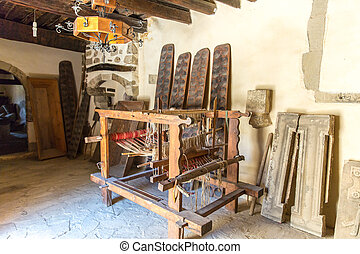 Loom with threads in monastery in Messara Valley Crete,...