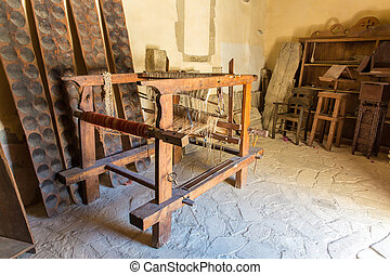 Loom with threads in Museum with artifacts of ancient Greek...