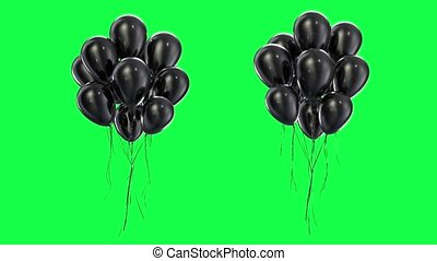 Loop Bundle of black balloons on a green background in 4k