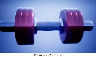 loop metal dumbbell rotate on colored background