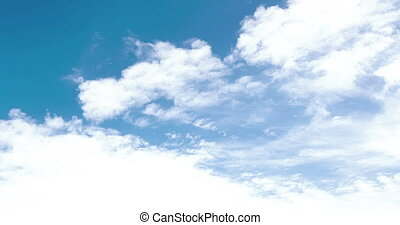 loop of white clouds over blue sky time lapse