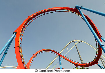 loop roller coaster on blue sky