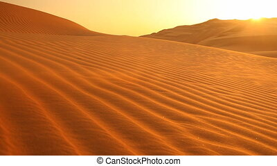loop sunset in dunes with sand blowing - seamlessly loopable...
