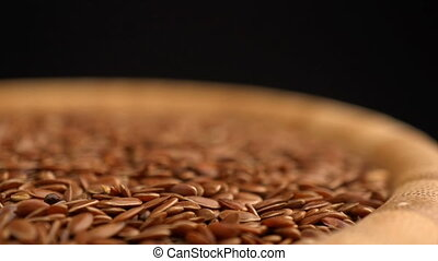 flax seeds rotating background - Loopable many flax seeds...