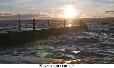 Loopable sunset over pier in 4k - 4k Loopable dusk over pier