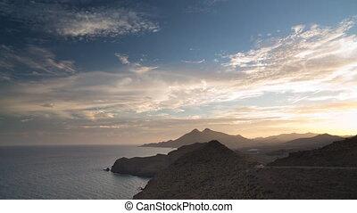 Loopable video of clouds over coastline, Cabo de Gata Nijar...