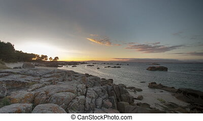 Loopable video of sunset over beach, Galicia, Spain - ...