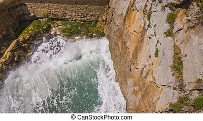 Loopable waves over wall - Closeup of waves over wall,...