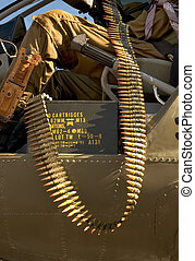 Large caliber ammunition hanging out of a helicopter.