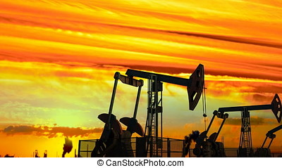 Looped move along oil pump jacks against dusk - Looped move...