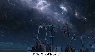 Looped move along oil pump jacks under night sky - Looped...