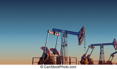 Looped move oil pump jacks against blue sunset sky - Looped...
