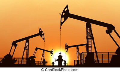 Looped oil pumpjacks against orange sunset sky - Oil...