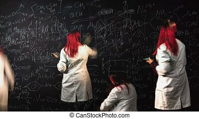 Looped time lapse of a female student writing chemistry formulas and drawing graphics on blackboard