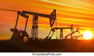 Looped working oil pump jacks against dusk - Looped working...