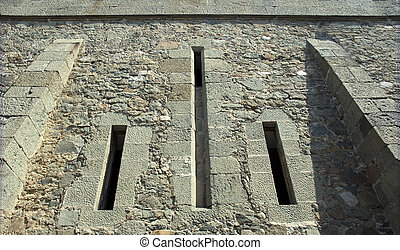 Loophole in a defensive wall ancient castle (the Crimean...