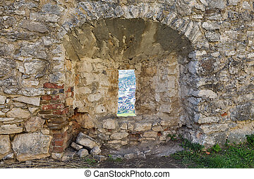 Loophole of Spis Castle in Slovakia. Spissky hrad, National...