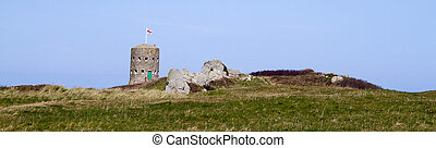loophole towers in Guernsey that guard the coastline. -...