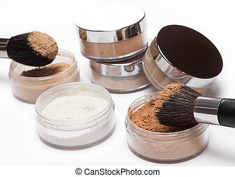 Loose cosmetic powder different colors with makeup brushes