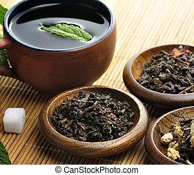 Loose Green Tea - Cup Of Tea And Loose Tea Assortment