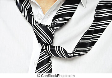 loose tie - a man with his shirt and his tie loosened