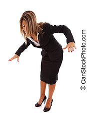 businesswoman loosing her balance (isolated on white)