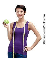 Loosing weight woman with flexible ruler and green ripe apple, isolated on white