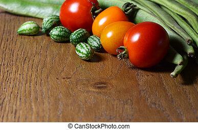 loper, cucamelons, bonen, rood, sinaasappel, tomaten