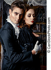 lord dracula - Beautiful man and woman vampires dressed in...