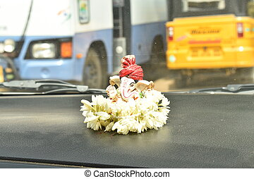 LORD GANESH IDOL ON THE CAR DASHBOARD