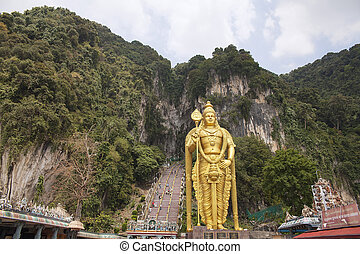 Lord Murugan Hindu Deity Statue at Batu Caves in Malaysia