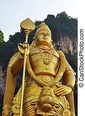 Lord Murugan statue at the hindu Batu caves on the outskirts of Kuala Lumpur.