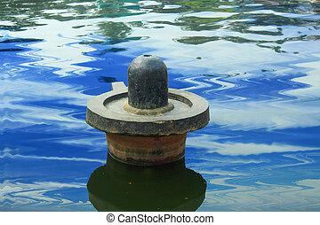 lord shiva linga in a water