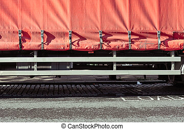 Protective cover fastened on the back of a large freight lorry