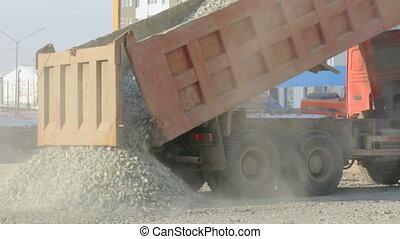 Lorry-truck unloading at construction site